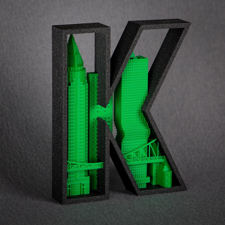 Buchstabe K - Silhouette Frnkfurt - MesseTurm - OmniTurm